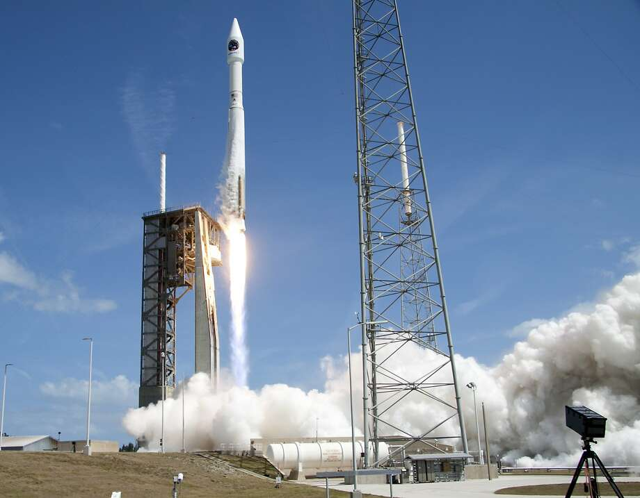 An Atlas V rocket will carry supplies to the International Space Station after lifting off from Cape Canaveral. It's due there Saturday, two days after the arrival of two fresh astronauts. Photo: John Raoux, Associated Press