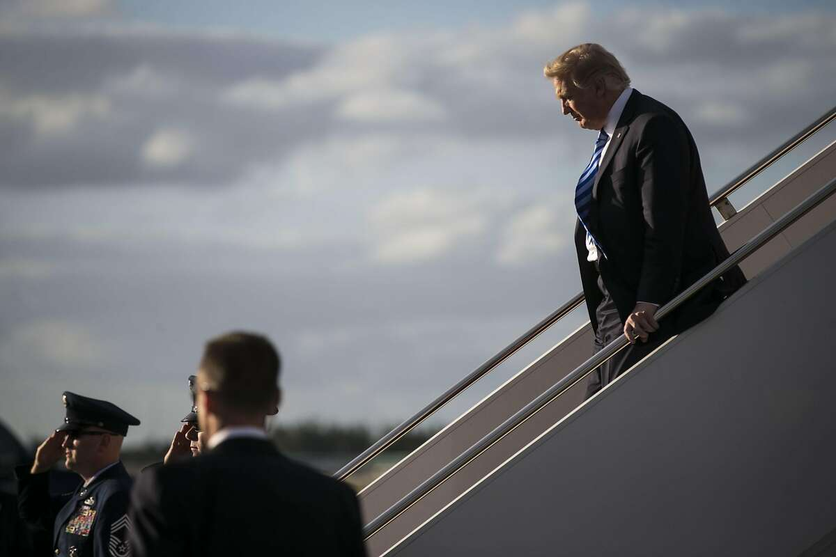 FILE -- President Donald Trump arrives in West Palm Beach, Fla., for a three-day stay at his Mar-a-Lago resort, April 13, 2017. Trump administration figures are meeting Tuesday to discuss America's involvement in the Paris climate accords, which the president vowed repeatedly to cancel on the campaign trail.
