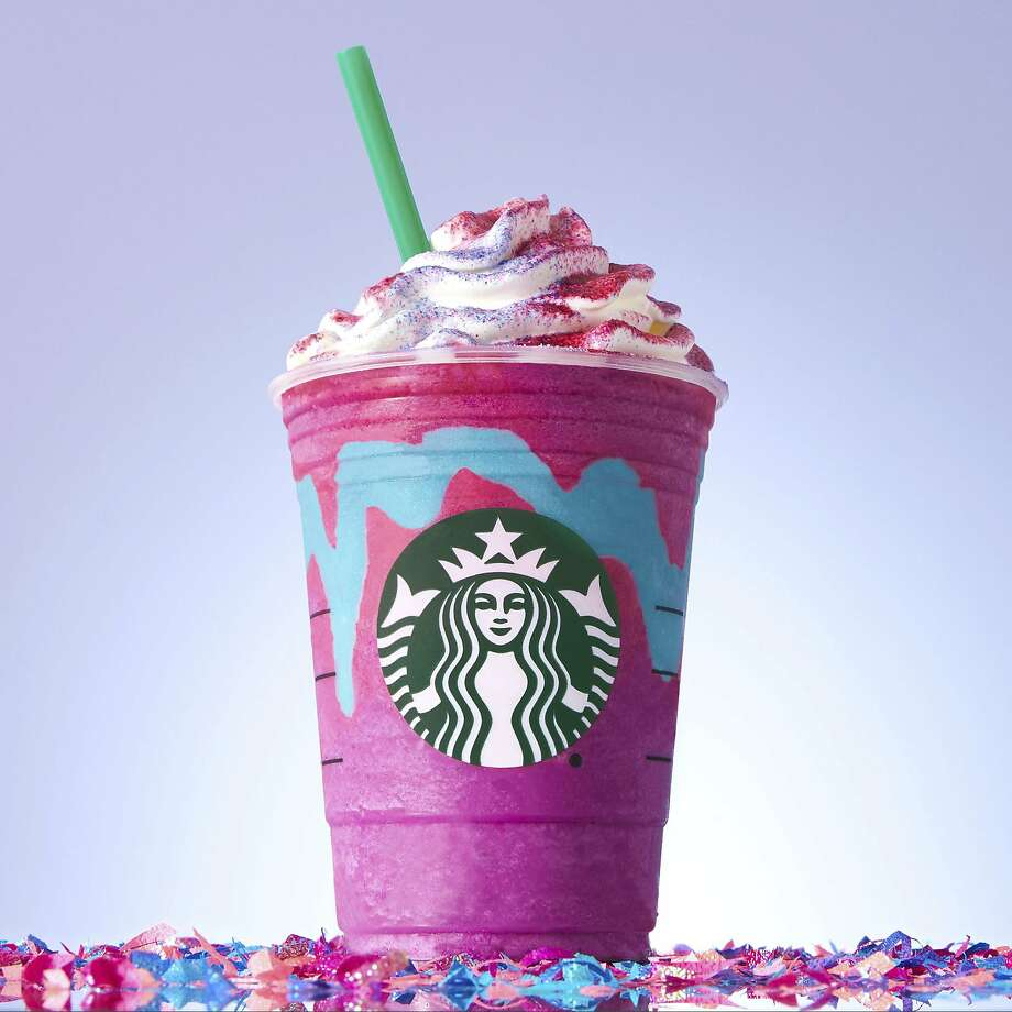 """This photo provided by Starbucks shows the company's �Unicorn Frappuccino."""" Starbucks says its newest beverage not only changes colors with a stir of the straw, but flavors as well. The Seattle chain says its �Unicorn Frappuccino� starts as a purple drink with blue swirls that tastes sweet and fruity, before changing to pink with a tangy and tart taste with a stir of the straw. The company says the drink is available for a limited time while supplies last, from April 19 to April 23, 2017, in the United States, Canada and Mexico. (Starbucks via AP) Photo: Associated Press"""