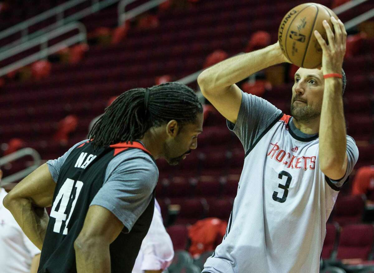 Houston Rockets forward Ryan Anderson (3) taks a shot over Houston Rockets center Nene (42) during practice at Toyota Center on Tuesday, April 18, 2017, in Houston. The Rockets play the Oklahoma City Thunder in Game 2 of first round of the NBA Western Conference Playoffs on Wednesday at Toyota Center.