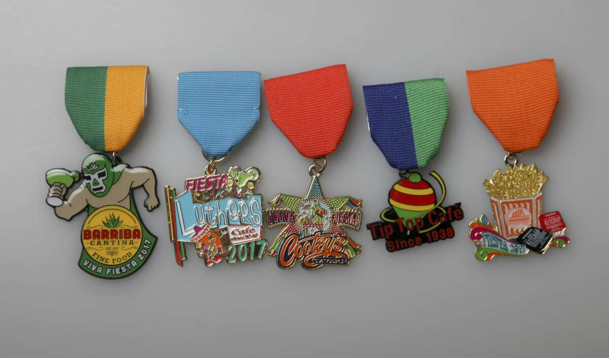 Check out the 400-plus medals submitted in the 2017 San Antonio Express-News Fiesta Medals Contest. From left, Barriba Cantina, 111 W. Crockett on the Riverwalk, $8; Luther's Bar & Cafe; Cootey?'s Tavern, $5, 8318 Jones Maltsberger; Tip Top Café, $50, 2814 Fredericksburg Road, includes 100 Club of San Antonio Fiesta medal, two $20 gift certificates, while supplies last; and Whataburger, $9.99, Whataburger.com.