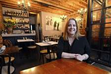 Carrin Schechter, owner of Noir Stamfod, is photographed inside the dining room of her Stamford restaurant on April 6, 2017.