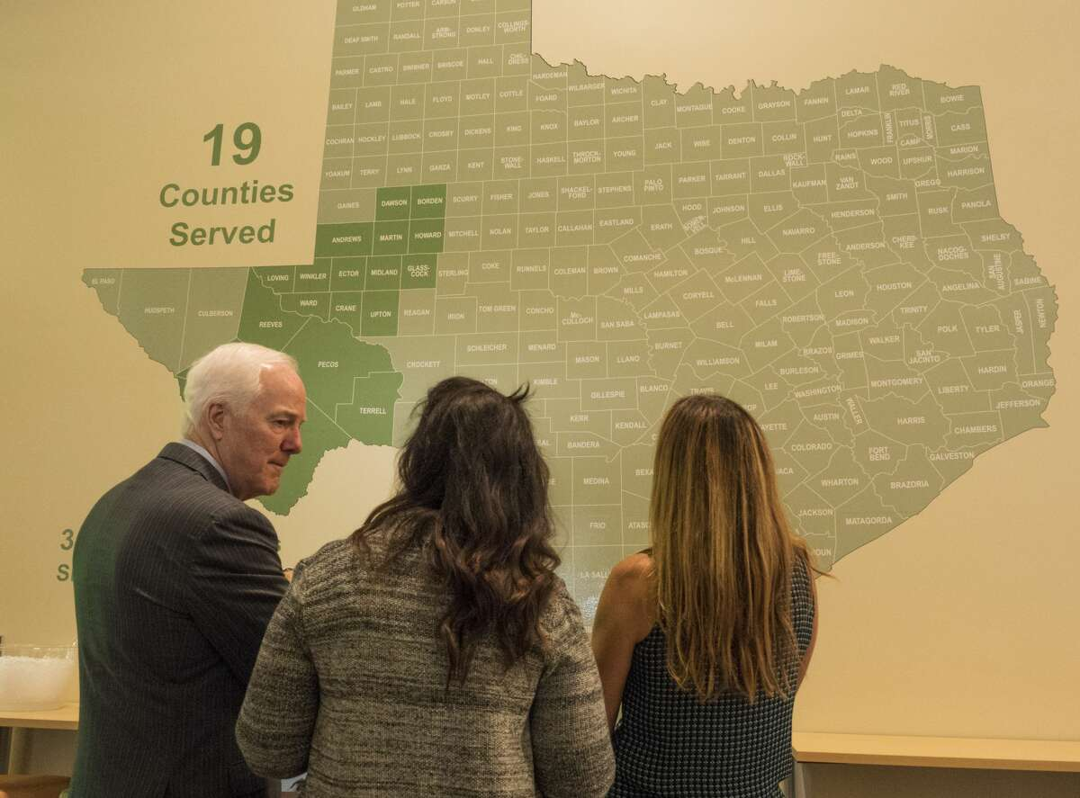 U.S. Sen. John Cornyn, left, talks with Libby Campbell, executive director of West Texas Food Bank, center, and Celia Cole, CEO of Feeding Texas in April before announcing new legislation on helping end hunger. The Reporter-Telegram has designated the food bank as Organization of the Year.