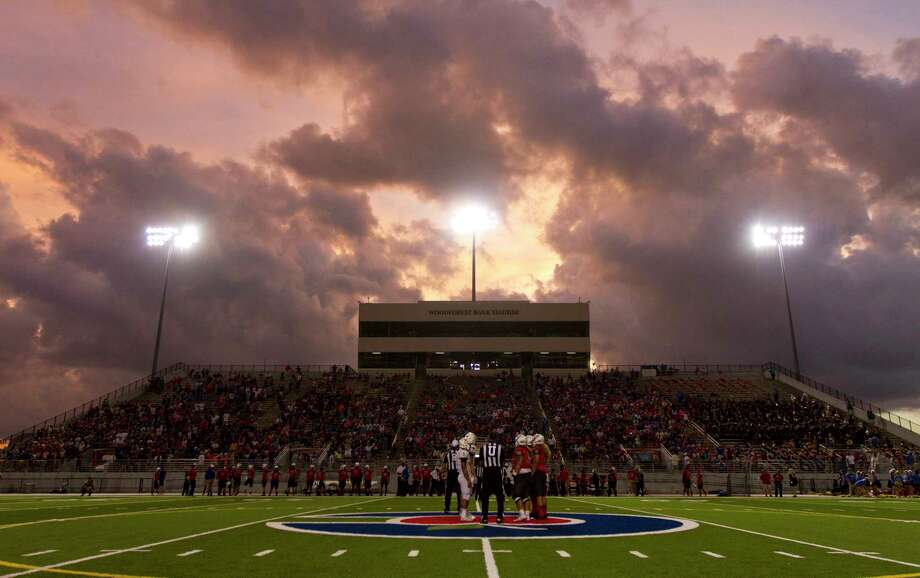 Oak Ridge and Deer Park meet at midfield as storm clouds roll in before the first quarter of a non-district high school football game Friday, Sept. 16, 2016, at Woodforest Bank Stadium. Photo: Jason Fochtman, Staff / Houston Chronicle