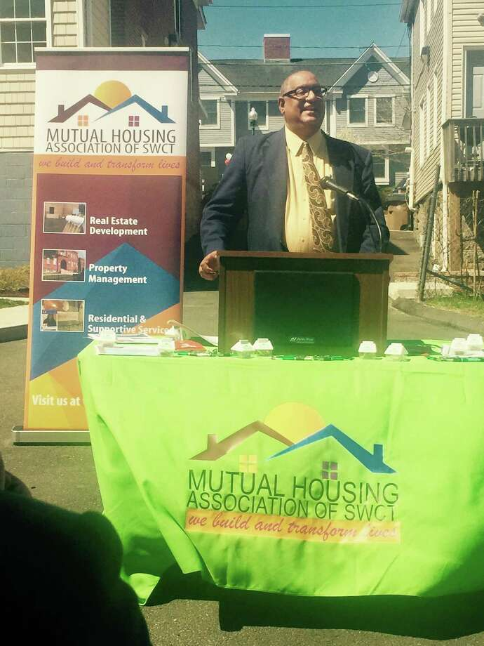 Morris Mendes, a resident at Mutual Housing Association of Southwestern Connecticut's Fairfield Commons development, speaks at a groundbreaking for new units on April 18, 2017. Photo: Contributed