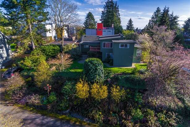 This eclectic home comes with a full backyard, as well as an upper deck connected to the living room. Enjoy views looking over Columbia City (and beyond, on a clear day) from the deck or from the wide windows of the living area.   2612 S. Ferdinand St., listed at $550,000. See the  full listing here .