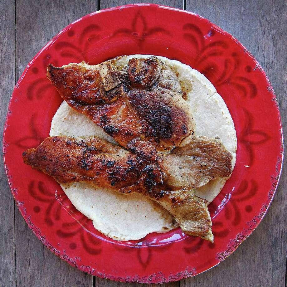 Pork chop taco on a handmade corn tortilla from Benjamin's Kitchen. Photo: Mike Sutter /San Antonio Express-News