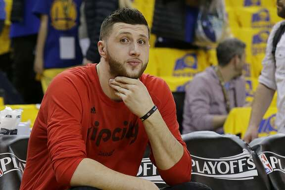 Portland Trail Blazers center Jusuf Nurkic sits on the bench before Game 1 of a first-round NBA basketball playoff series between the Golden State Warriors and the Trail Blazers in Oakland, Calif., Sunday, April 16, 2017. (AP Photo/Jeff Chiu)