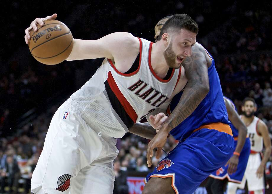 FILE - In this March 23, 2017, file photo, Portland Trail Blazers center Jusuf Nurkic, left, drives past New York Knicks center Kyle O'Quinn during the second half of an NBA basketball game in Portland, Ore. His arrival sparked the lackluster Trail Blazers and he quickly became a fan favorite in Portland. Now Rip City anxioulsy waits to see when _ and if _ big man Jusuf Nurkic will return for the playoffs.(AP Photo/Craig Mitchelldyer, File) Photo: Craig Mitchelldyer, Associated Press