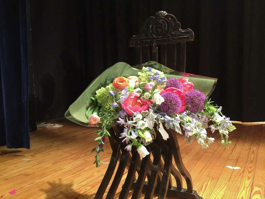 Joan Caldwell's chair, now covered in flowers, stood in place of the longtime RTM member who died last week at the RTM meeting Monday. Photo: Contributed