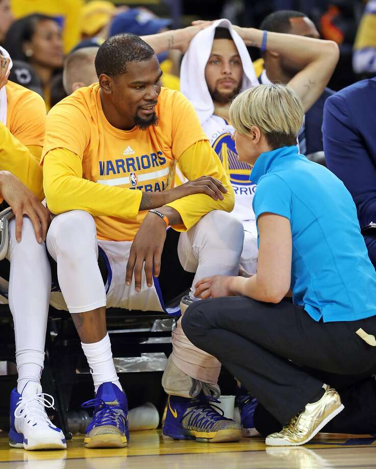 ce2e1e4a350a Golden State Warriors  Kevin Durant confers with trainer Chelsea Lane after  straining his calf during