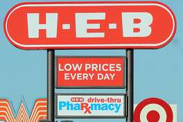 A Target sign (right) is next to an H-E-B sign on Southeast Military Drive near Brooks City-Base. H-E-B plans to adapt to increasing competition from stores like Target and Wal-Mart.