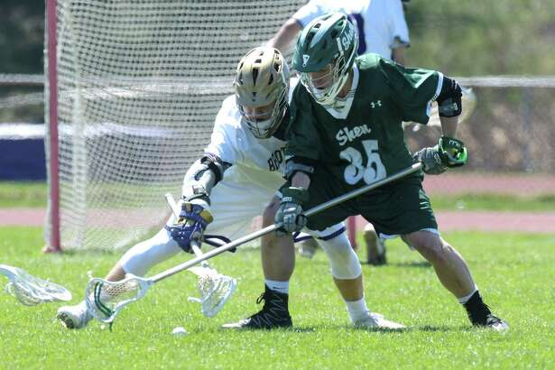 Hunter Pemrick of CBA, left, and Eric Westervelt of Shenendehowa battle for a ground ball during the CBA and Shenendehowa boy's high school lacrosse game on Tuesday, April 18, 2017, in Colonie, N.Y.  (Paul Buckowski / Times Union)