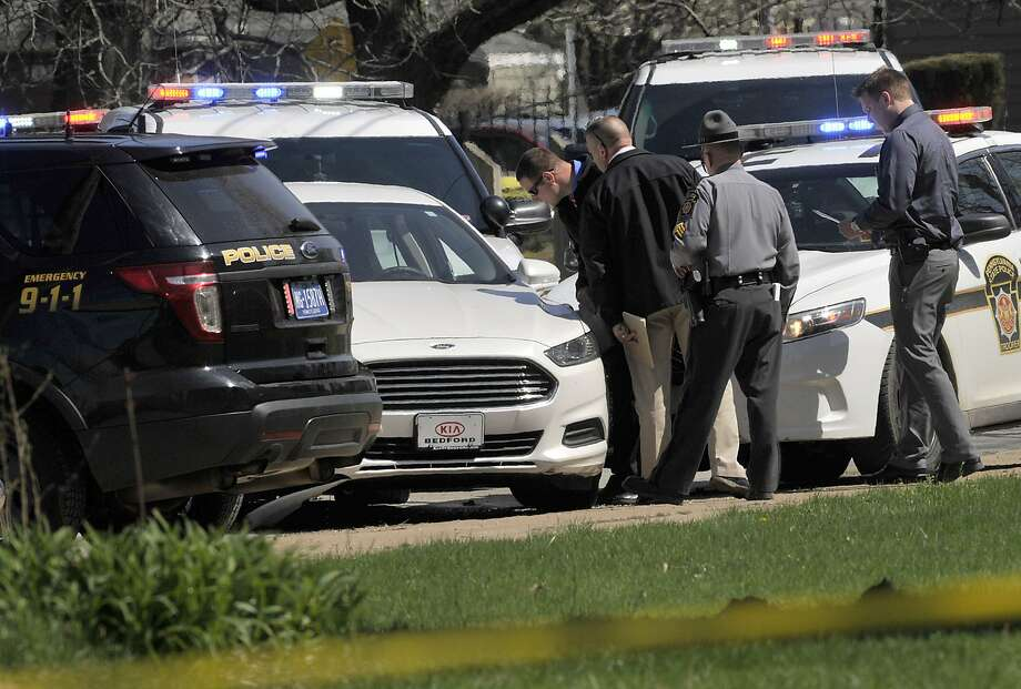 Pennsylvania State Police investigate the scene where Steve Stephens killed himself two days after posting video on Facebook of his slaying of a Cleveland retiree. Police pursuing Stephens had bumped his car, which spun around and came to a stop. Photo: Greg Wohlford, Associated Press