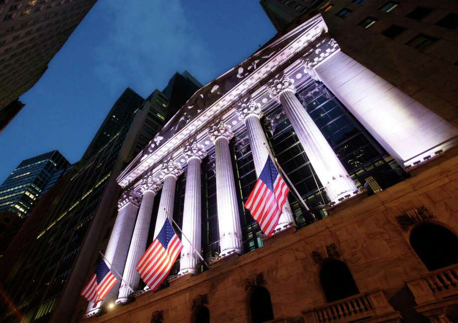 FILE - In this Oct. 8, 2014, file photo, American flags fly in front of the New York Stock Exchange. World stocks fell Tuesday, April 18, 2017, amid concerns about the security situation on the Korean Peninsula, France's upcoming presidential election, and Britain's surprise decision to hold a general election. (AP Photo/Mark Lennihan, File) Photo: Mark Lennihan, STF / Copyright 2016 The Associated Press. All rights reserved. This material may not be published, broadcast, rewritten or redistribu