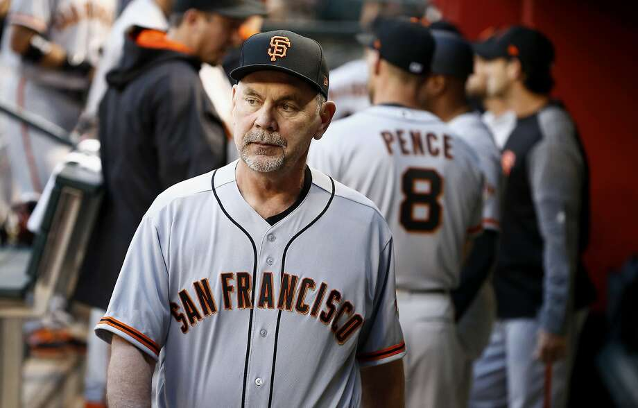 Bruce Bochy is in his 11th season managing the Giants. The team hopes he can return to the dugout Friday in Denver. Photo: Ross D. Franklin, Associated Press