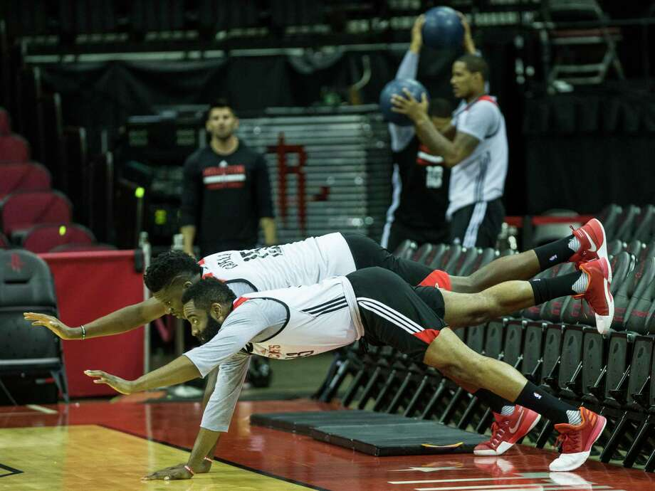 Basketball gives way to a bit of ballet as Rockets guard James Harden, foreground, and center Clint Capela loosen up before a workout at Toyota Center in anticipation of Game 2 tonight. In the background, other Rockets limber up with a different kind of ball. Photo: Brett Coomer, Staff / © 2017 Houston Chronicle