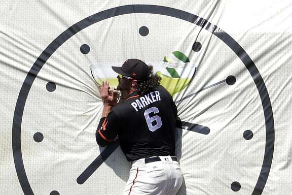 San Francisco Giants' Jarrett Parker (6) is unable to make the catch on a base hit by San Diego Padres' Hector Sanchez during the first inning of a spring training baseball game, Tuesday, March 21, 2017, in Scottsdale, Ariz. (AP Photo/Matt York)