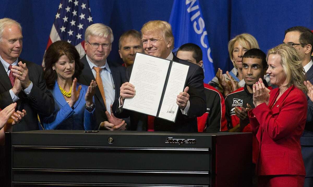 President Donald Trump signs the so-called