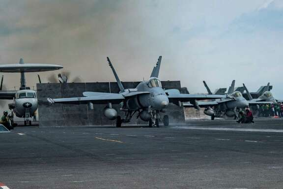 An F/A-18C Hornet prepares to launch from the aircraft carrier USS Carl Vinson during deployment in the Western Pacific, April 10, 2017. The photo was released by the U.S. Navy. With signs indicating that North Korea could be planning a nuclear or missile test as early as Saturday, April 15, 2017, a United States Navy strike group led by the Carl Vinson is steaming toward the Korean Peninsula in a show of force. (U.S. Navy photo by Mass Communication Specialist Seaman Jake Cannady via The New York Times)