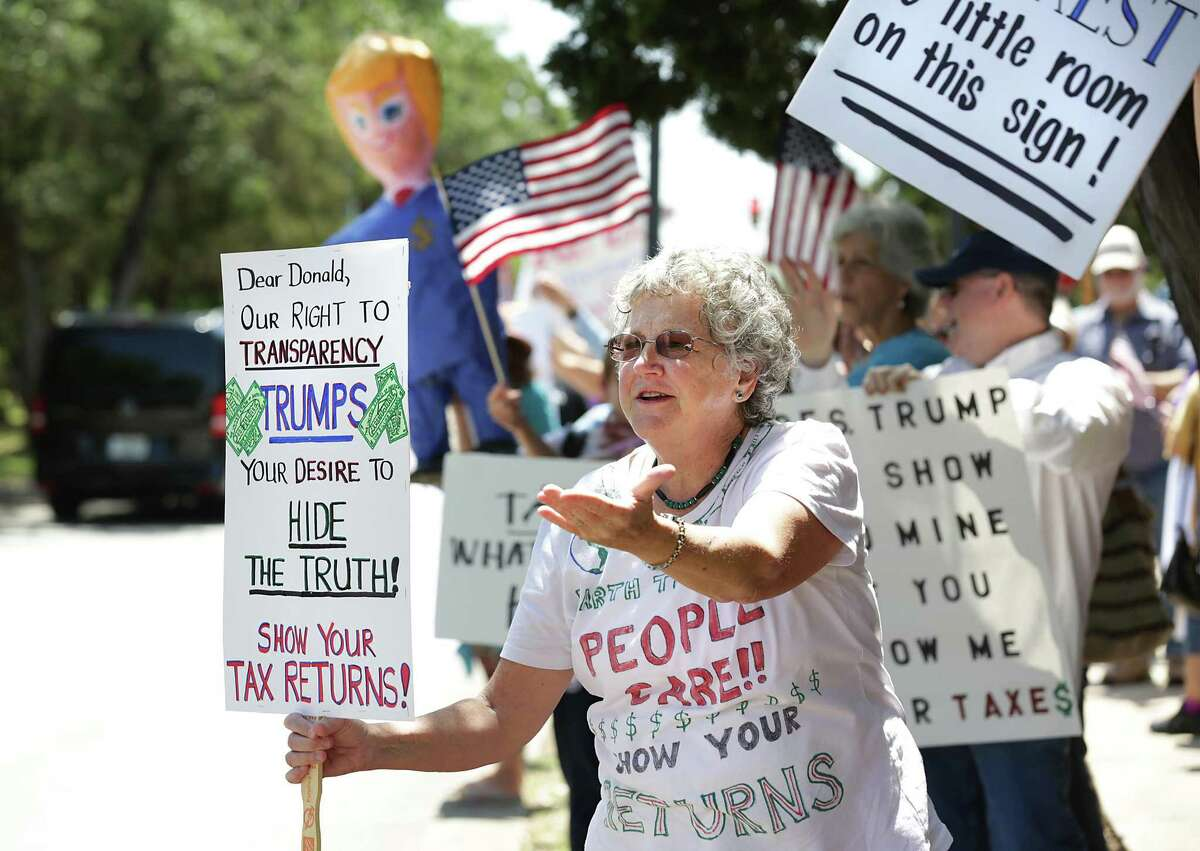 Julie Love and more than 100 protestors marched to Congressman Will Hurd's office on Rogers Ranch Road on Tuesday, April 18, 2017, pushing for the release of President Trump's taxes.