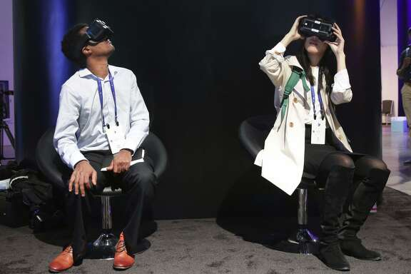 Inside the Festival Hall Danti Hailu (left) and Ke Ku, try out the Facebook's Surround 360, at the F8 Facebook Developer Conference in San Jose, Calif. on Tues. April 18, 2017.