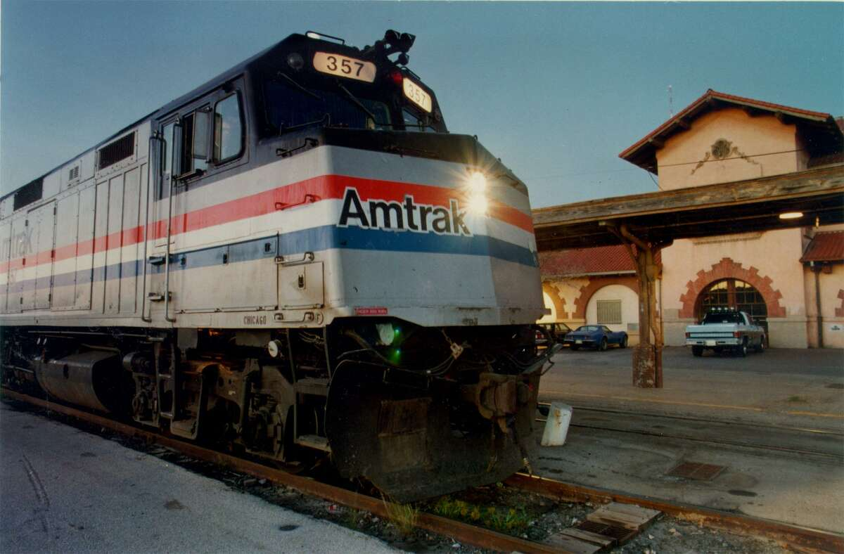 An Amtrak train chugs past Sunset Depot in 1989, before the station was renovated.