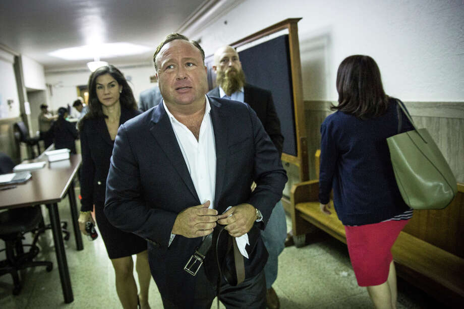 "In this Monday, April 17, 2017 photo, ""Infowars"" host Alex Jones arrives at the Travis County Courthouse in Austin, Texas. Jones, the right-wing radio host and conspiracy theorist, is a performance artist whose true personality is nothing like his on-air persona, according to a lawyer defending the ""Infowars"" broadcaster in a child custody battle. (Tamir Kalifa/Austin American-Statesman via AP) Photo: Tamir Kalifa, MBO / AMERICAN-STATESMAN"