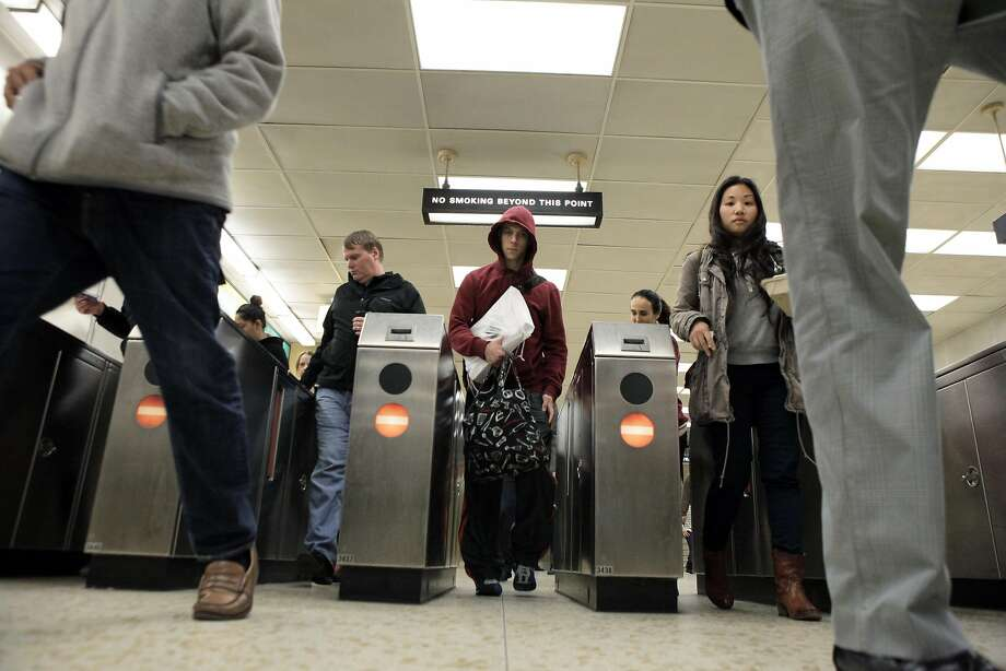 BART riders pass through the gates at the Rockridge BART station. Photo: Carlos Avila Gonzalez, The Chronicle