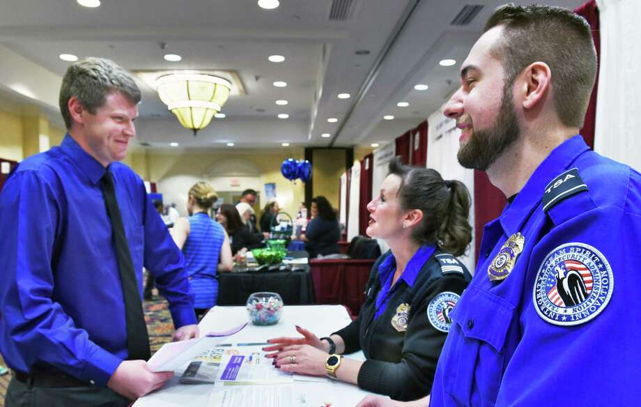 John Gunther, left, of Arlington, Vt., speaks with Transportation Security Administration recruiters STSO Mary Bagnoli and TSO Kevin Gallagher during the Times Union job fair Tuesday April 18, 2017 in Colonie, NY.  (John Carl D'Annibale / Times Union) Photo: John Carl D'Annibale / 20040295A