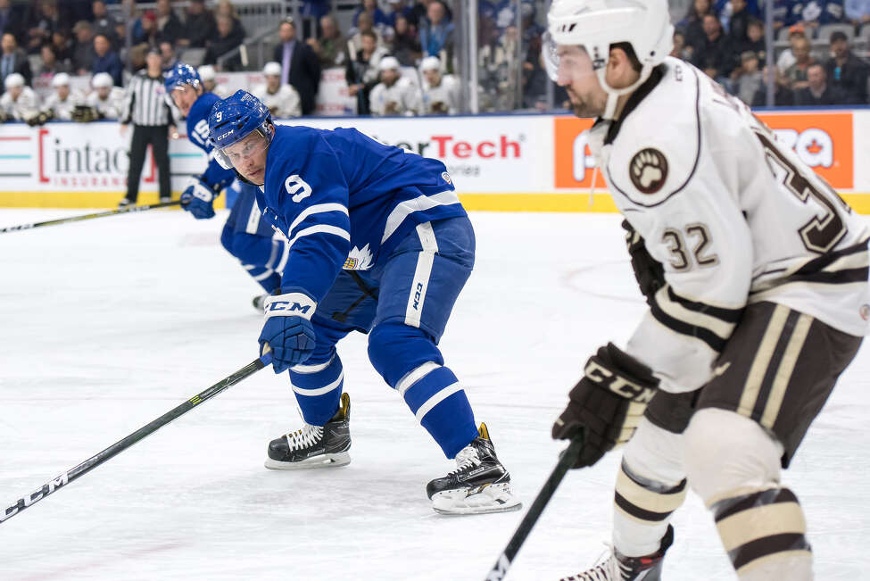 Toronto Marlies right wing Mike Sislo looks for room against Hershey Bears defenseman Hubert Labrie. Sislo played parts of six seasons for the Albany Devils. (Photo courtesy Toronto Marlies)