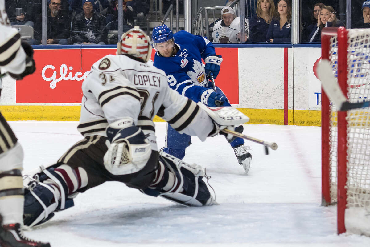 Toronto Marlies right wing Mike Sislo tries to beat Hershey Bears goaltender Pheonix Copley in a 2017 game in Toronto. Sislo played parts of six seasons for the Albany Devils. (Photo courtesy Toronto Marlies)