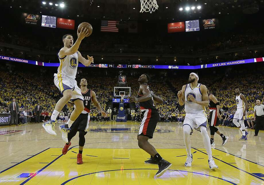 Golden State Warriors guard Klay Thompson (11) shoots against the Portland Trail Blazers during the second half of Game 1 of a first-round NBA basketball playoff series in Oakland, Calif., Sunday, April 16, 2017. The Warriors won 121-109. (AP Photo/Jeff Chiu) Photo: Jeff Chiu, Associated Press