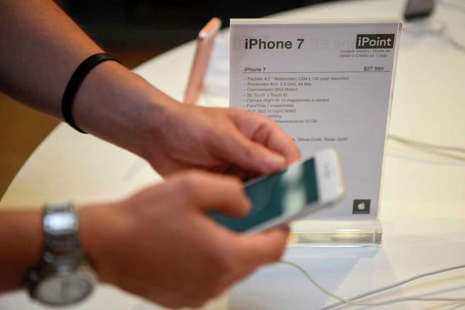 Apple's single most important product:  the iPhone. Photo: EITAN ABRAMOVICH, Staff / AFP or licensors