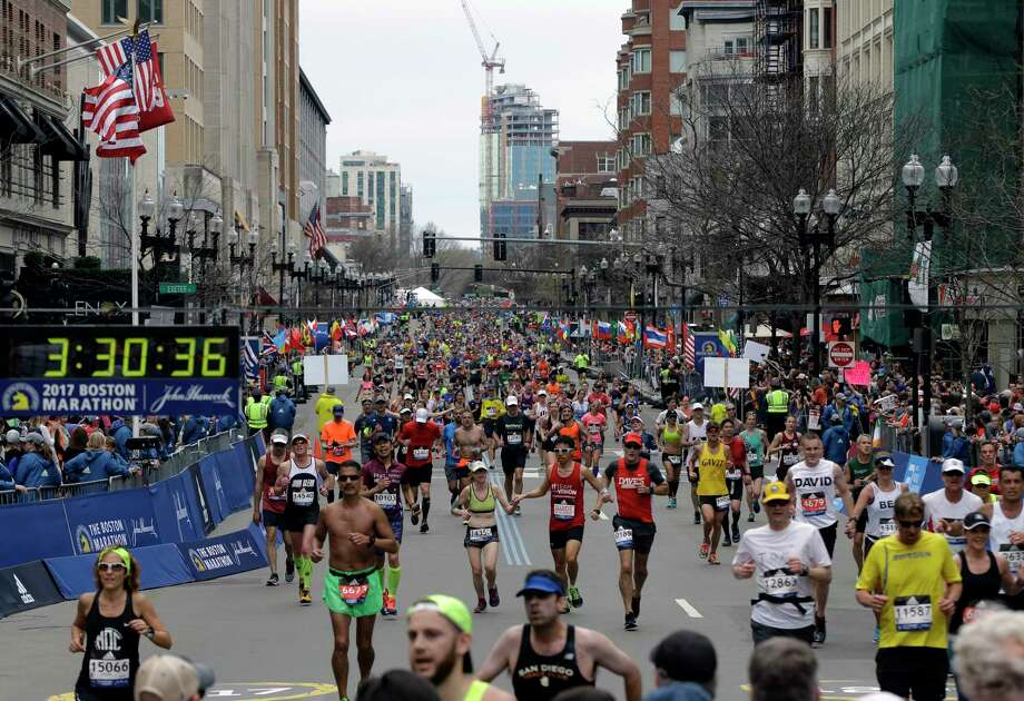 """FILE - In this Monday, April 17, 2017, file photo, runners head to the finish line in the 121st Boston Marathon in Boston. Adidas has apologized for sending out a marketing email using an unfortunate choice of words to praise customers who completed the Boston Marathon on Monday. The subject line of the email sent Tuesday by Adidas Running read: """"Congrats, you survived the Boston Marathon!"""" (AP Photo/Elise Amendola, File) Photo: Elise Amendola, STF / Copyright 2017 The Associated Press. All rights reserved."""