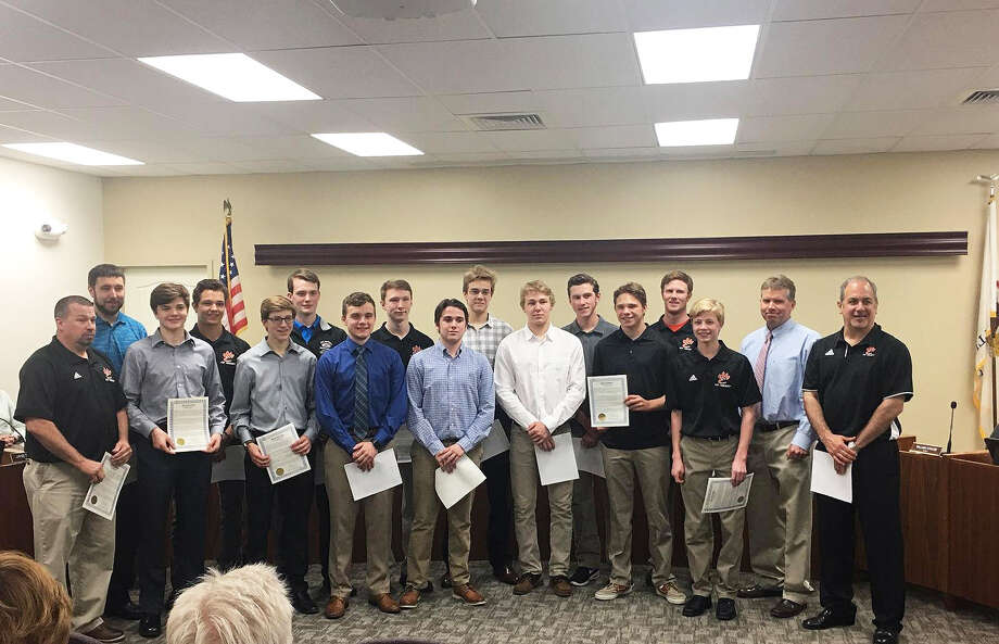 The Edwardsville ice hockey team poses for a photo after Mayor Hal Patton read a proclamation announcing Tuesday was EHS Ice Hockey Day.
