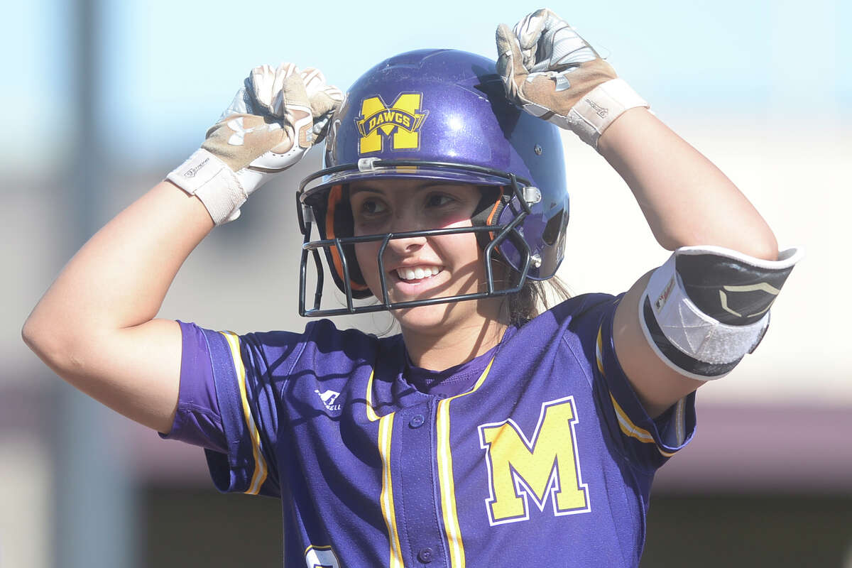 Midland High's Taylor Conner (2) reacts after a base hit against Lee on April 18, 2017, at Gene Smith Field. James Durbin/Reporter-Telegram