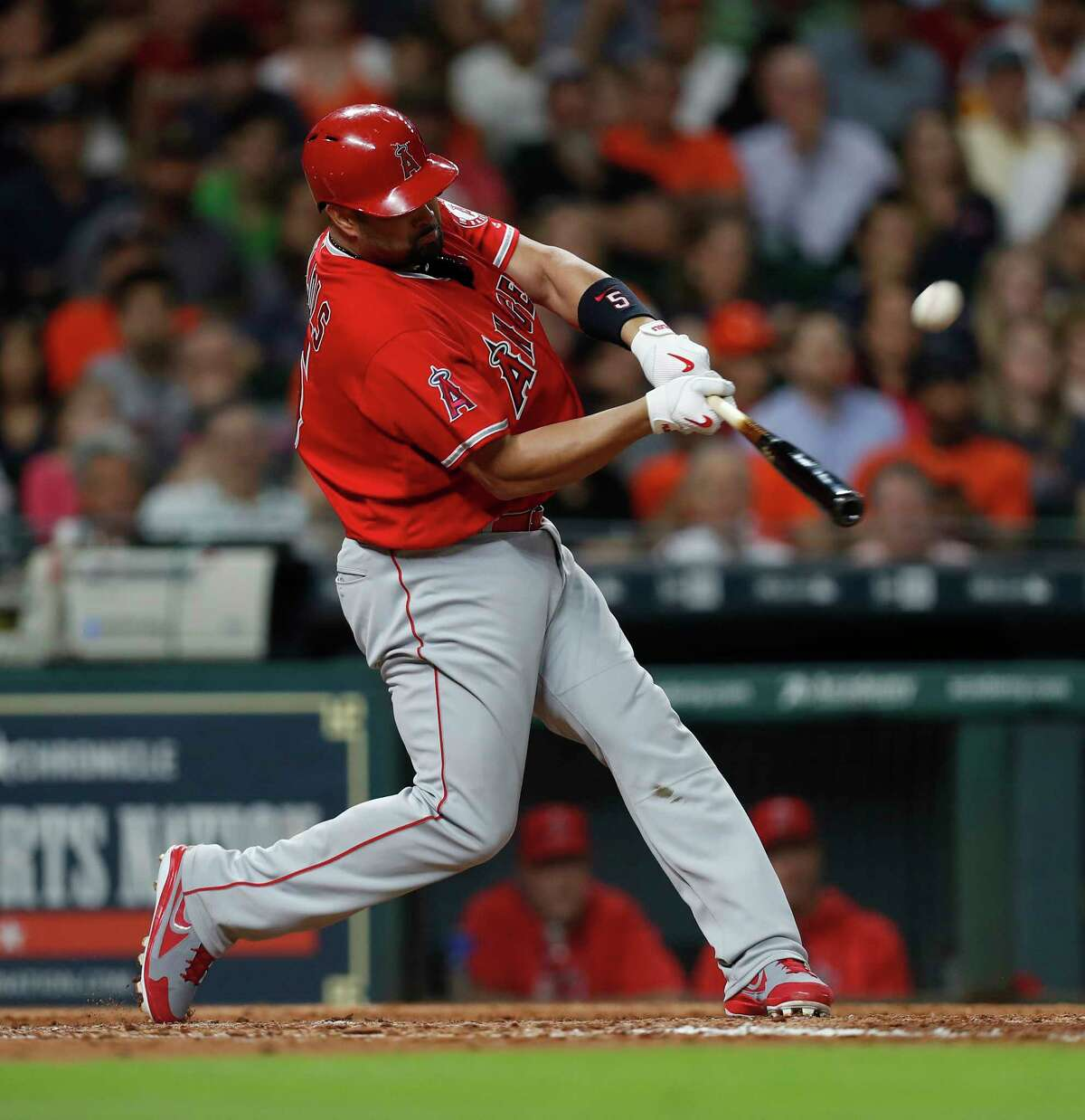 Los Angeles Angels designated hitter Albert Pujols (5) hits a three-run home run of of Astros starting pitcher Joe Musgrove during the fifth inning of an MLB baseball game at Minute Maid Park, Tuesday, April 18, 2017, in Houston.