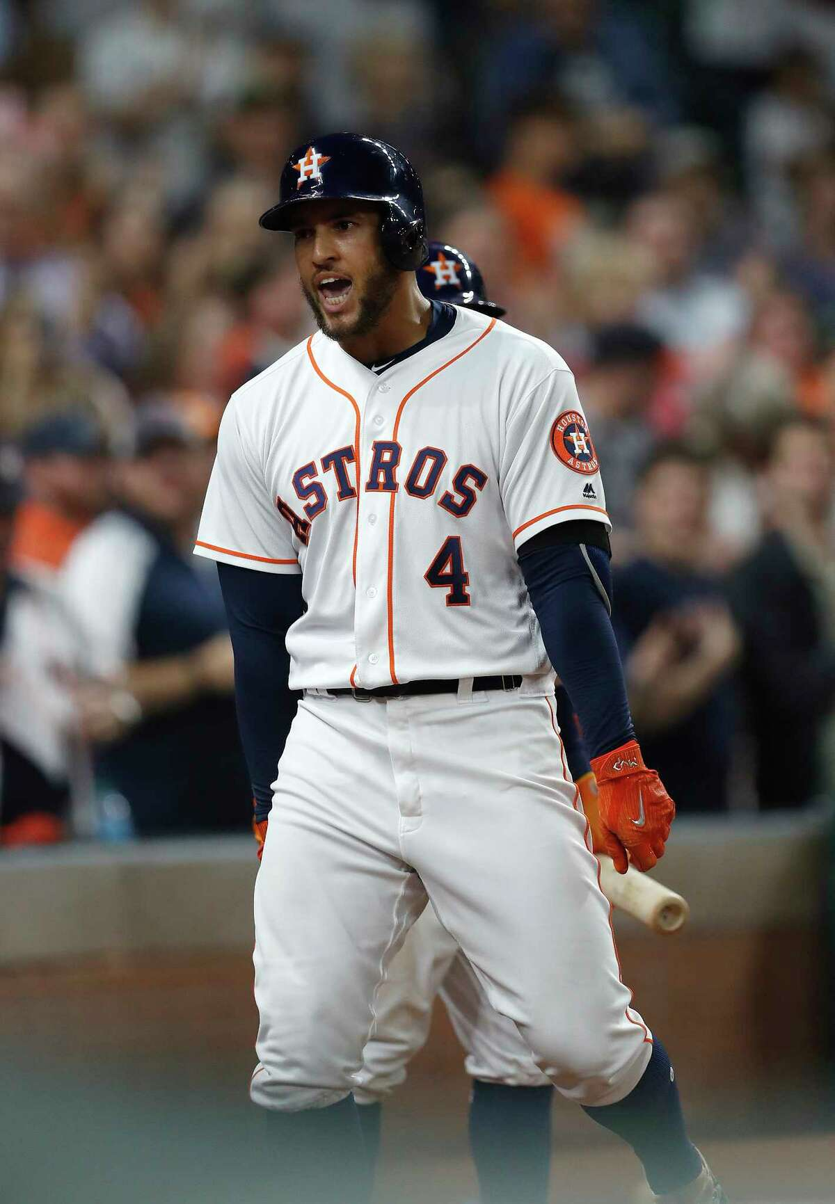 Houston Astros center fielder George Springer (4) celebrates his home run during the third inning of an MLB baseball game at Minute Maid Park, Tuesday, April 18, 2017, in Houston.
