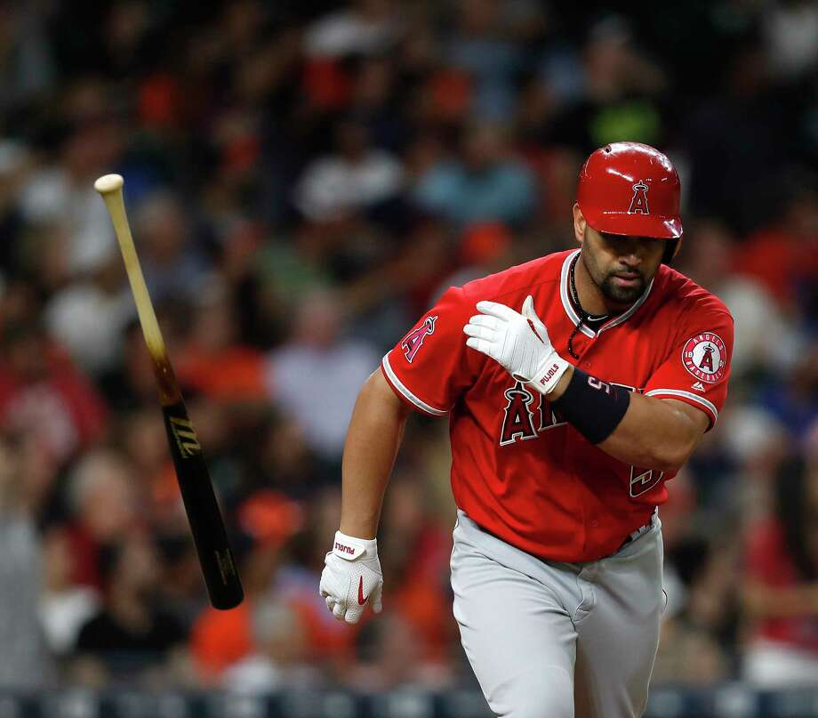 The main weapon of the Angels' Albert Pujols is no longer needed after he drives a three-run homer to left field to break a 2-2 tie in the fifth inning Tuesday night. Photo: Karen Warren, Staff Photographer / 2017 Houston Chronicle
