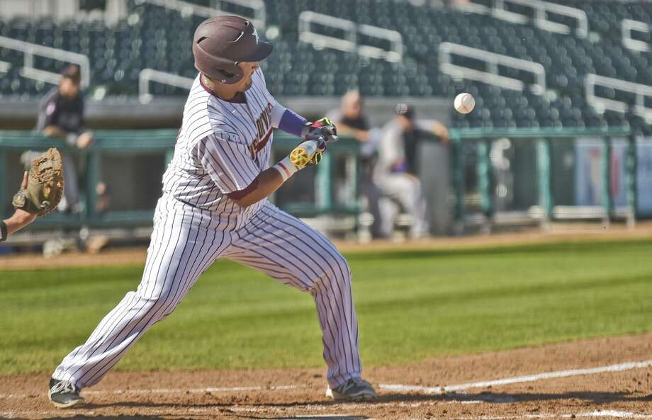Third baseman Sergio Pollorena and the Dustdevils scored two runs in the ninth inning but fell 4-3 at Texas A&M-Kingsville on Tuesday night. Photo: Danny Zaragoza /Laredo Morning Times File / LAREDO MORNING TIMES