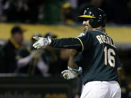 Oakland Athletics' Adam Rosales celebrates as he crosses home plate after hitting a two run home run off Texas Rangers' Yu Darvish in the sixth inning of a baseball game Tuesday, April 18, 2017, in Oakland, Calif. (AP Photo/Ben Margot)