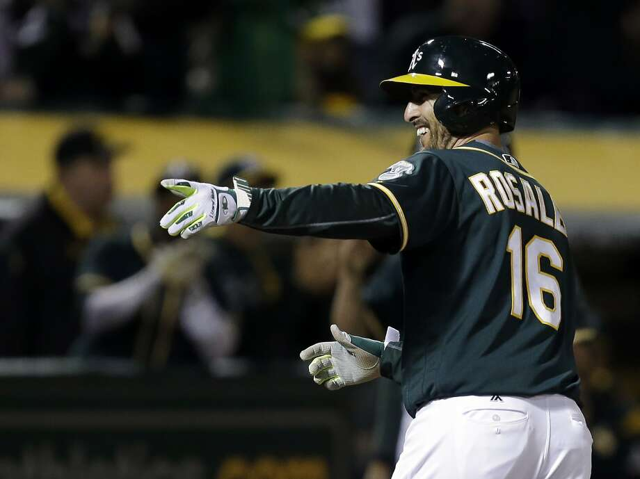 Adam Rosales celebrates as he crosses home plate after hitting a two-run homer in the sixth, the A's first runs since Saturday. Photo: Ben Margot, Associated Press