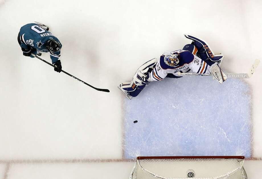 San Jose Sharks right wing Marcus Sorensen, left, scores past Edmonton Oilers goalie Cam Talbot during the second period in Game 4 of a first-round NHL hockey playoff series Tuesday, April 18, 2017, in San Jose, Calif. (AP Photo/Marcio Jose Sanchez) Photo: Marcio Jose Sanchez, Associated Press