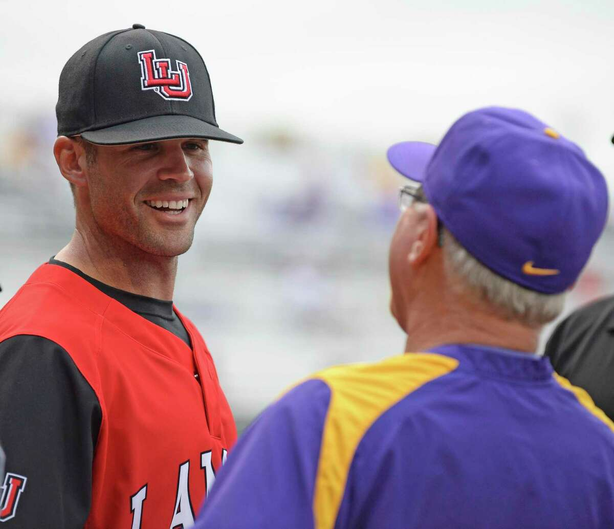 Former LSU volunteer coach and current Lamar head coach Will Davis, left, speaks with LSU head coach Paul Mainieri at home plate with the umpires before their teams compete, Tuesday, April 18, 2017, at LSU's Alex Box Stadium in Baton Rouge, La. Hilary Scheinuk/The Advocate