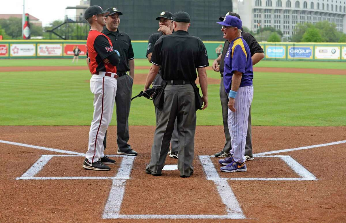 Former LSU volunteer coach and current Lamar head coach Will Davis, left, jokes with LSU head coach Paul Mainieri, right, at home plate with the umpires before their teams compete, Tuesday, April 18, 2017, at LSU's Alex Box Stadium in Baton Rouge, La.