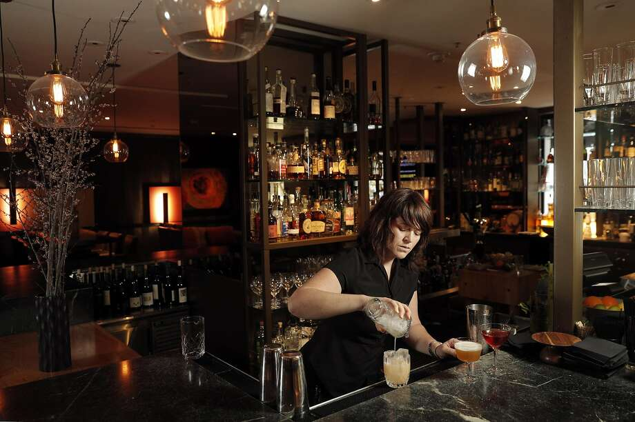 Bartender Amy Poitras prepares a cocktail at Parallel 37, the bar at the Ritz-Carlton in S.F. Photo: Carlos Avila Gonzalez, The Chronicle