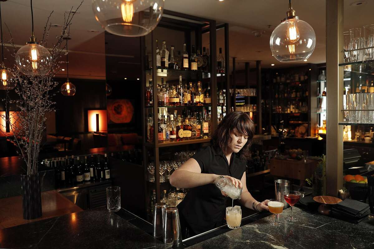 Bartender Amy Poitras prepares a cocktail at Parallel 37 the bar at the Ritz Carlton in San Francisco, Calif., on Tuesday, April 18, 2017.