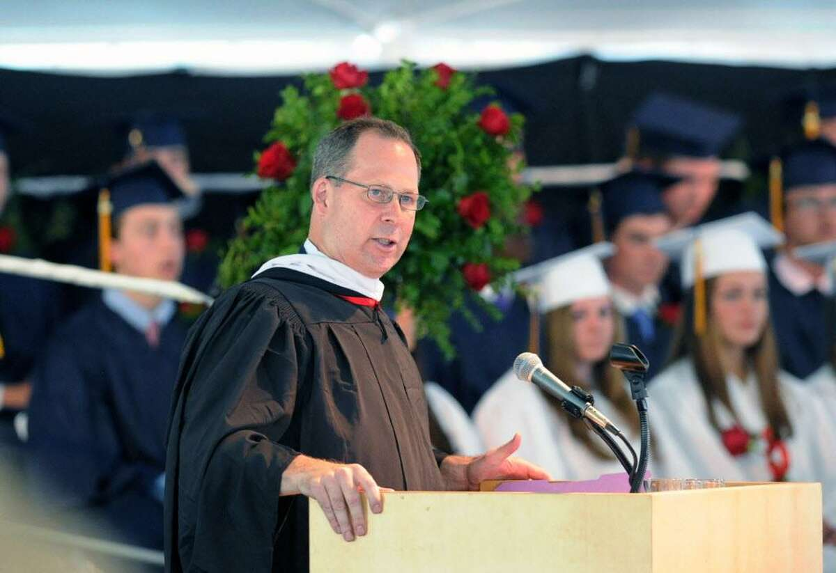 FILE - Thomas Main, head of King Low Heywood Thomas School, speaks during the commencement at the school in Stamford, Conn., Friday, May 29, 2015.