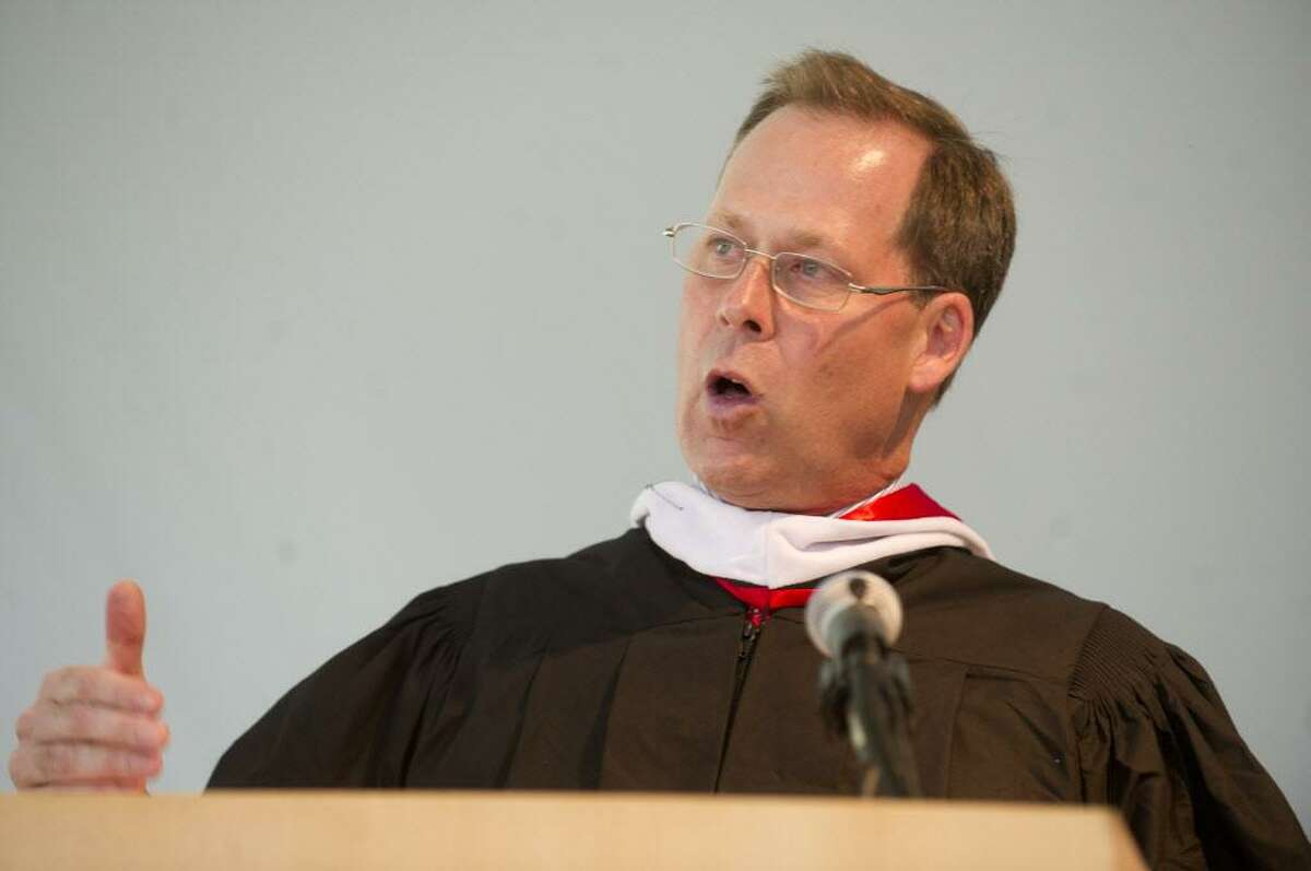 FILE - Thomas Main, Head of School, speaks during the King commencement ceremony on Friday, May 30, 2014.